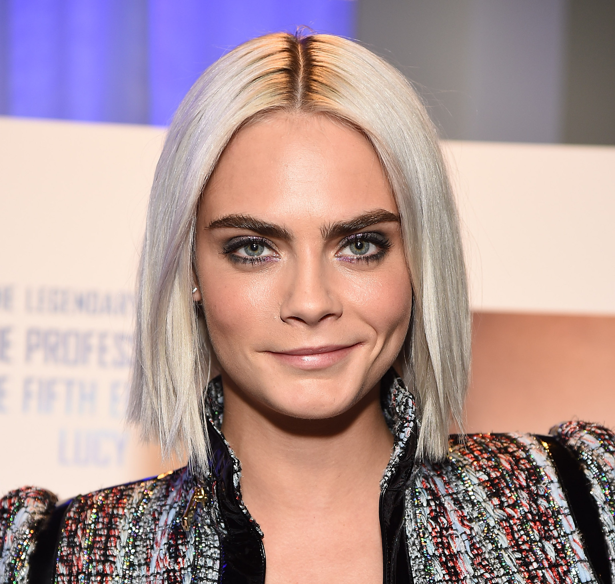 Cara Delevingne made a tweed ensemble edgy with the help of a lil' leather