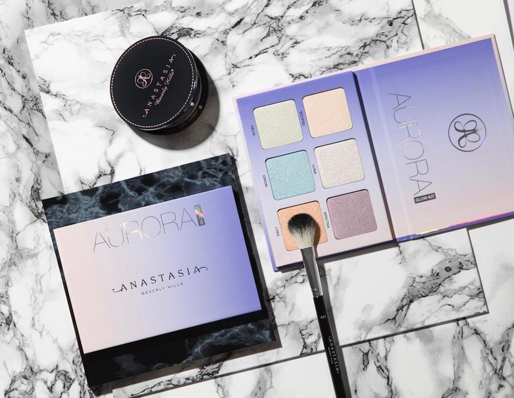 Anastasia Beverly Hills just swatched their new Aurora highlighter palette, and it's giving us LIFE