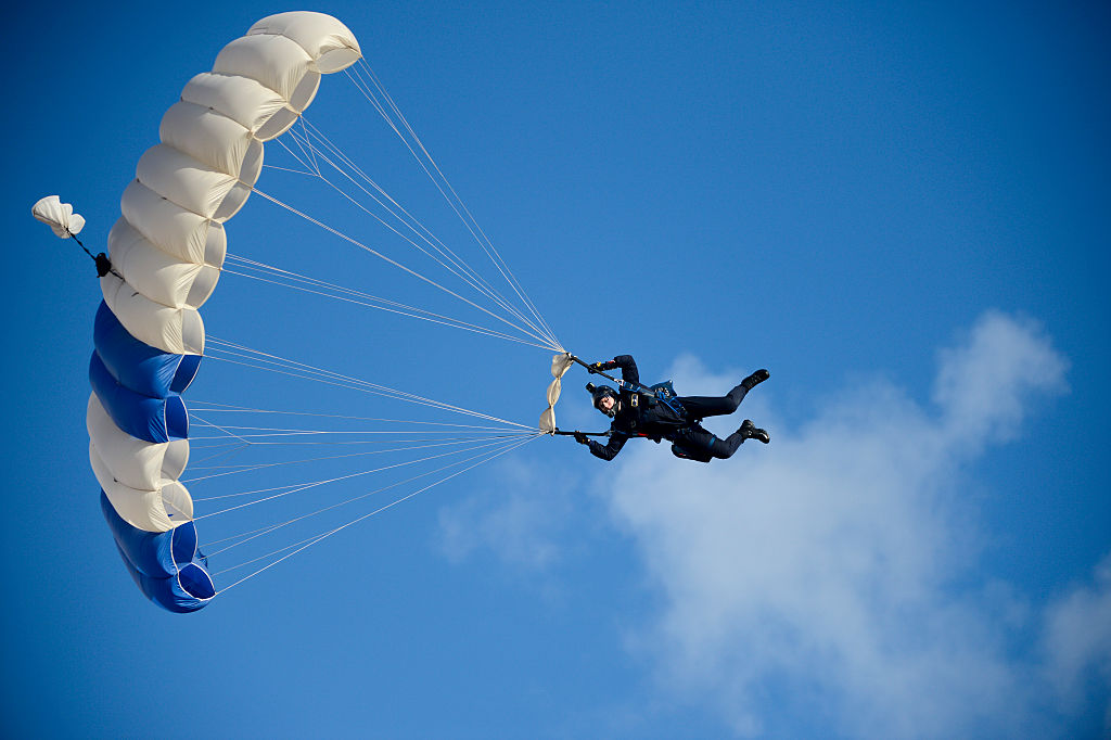 This skydiver's parachute AND back-up parachute both got tangled during a jump
