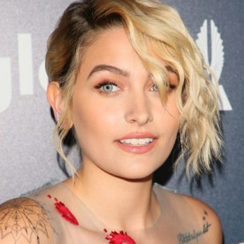 Paris Jackson's sheer gown looks inspired by a peacock, and comes complete with a cape