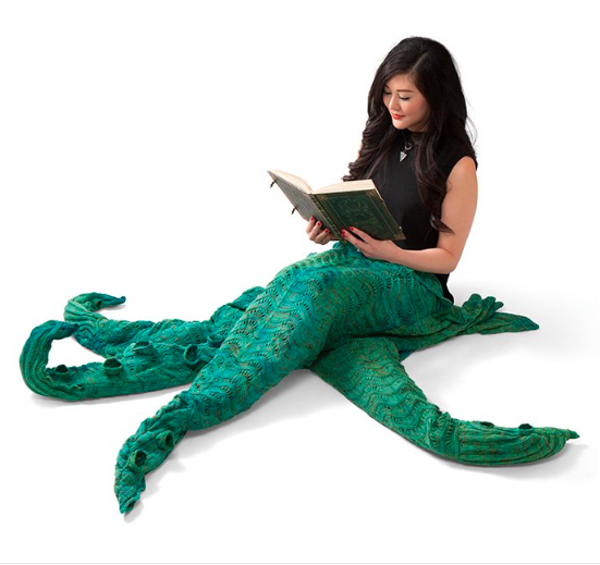 We need ThinkGeek to actually make this April Fool's twist on the mermaid blanket a real thing, and you can help