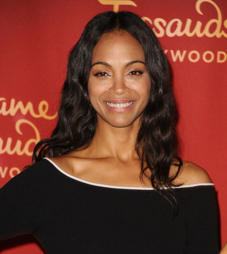 Zoe Saldana standing with a wax version of herself is freaking us out