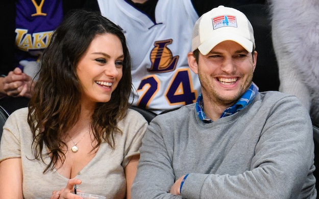 Ashton Kutcher says Mila Kunis kicks his butt every day (in the best way ever)