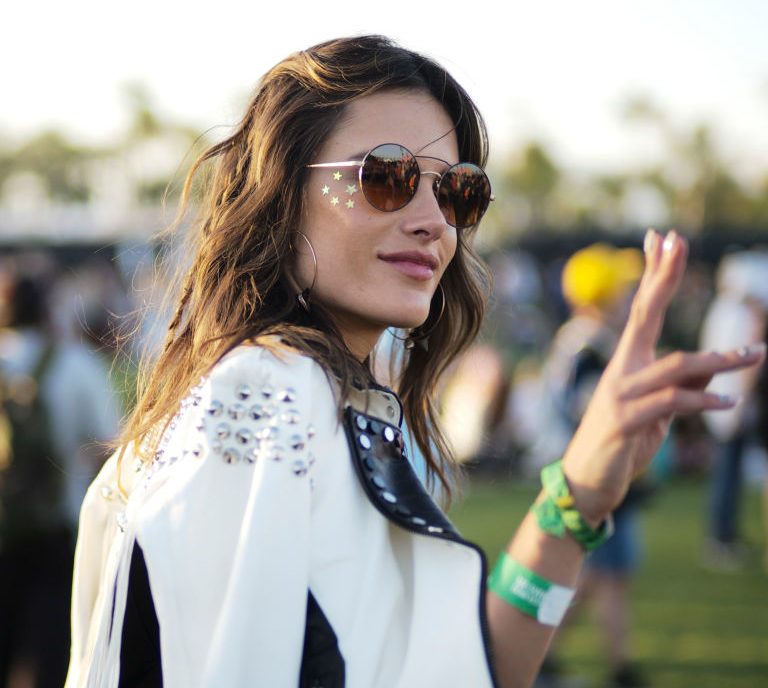 Vanessa Hudgens and Alessandra Ambrosio demonstrate how to wear glittery face tats at Coachella