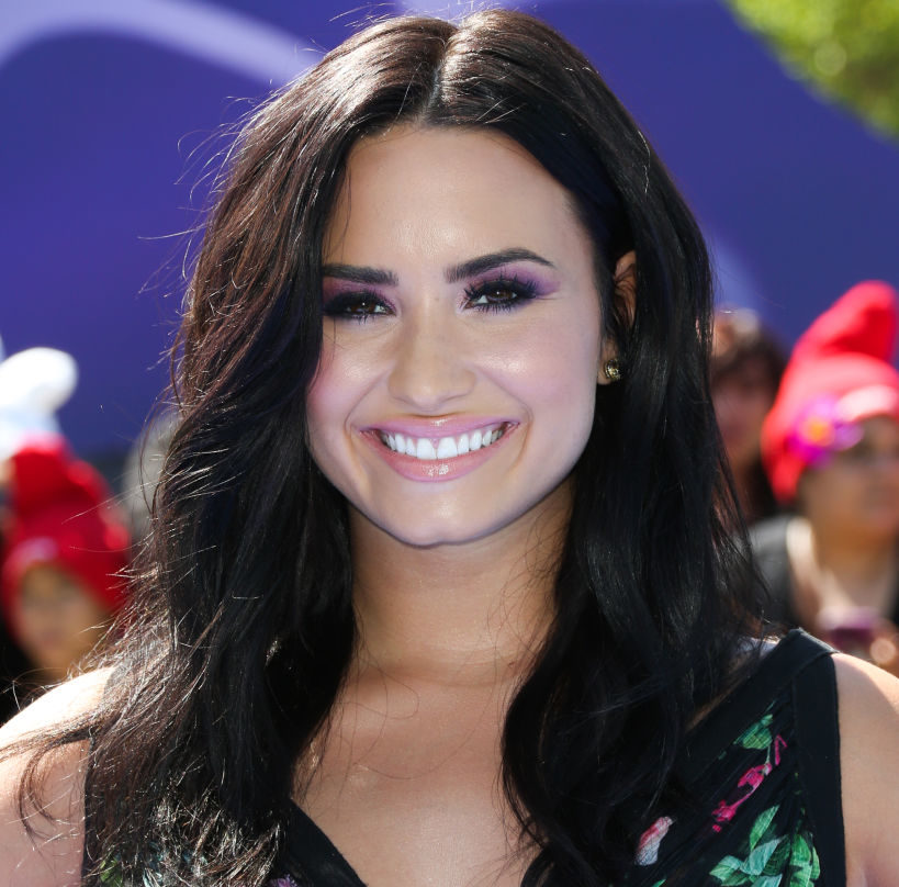 Demi Lovato's uber-plunging swimsuit is daring us to find one of our own!
