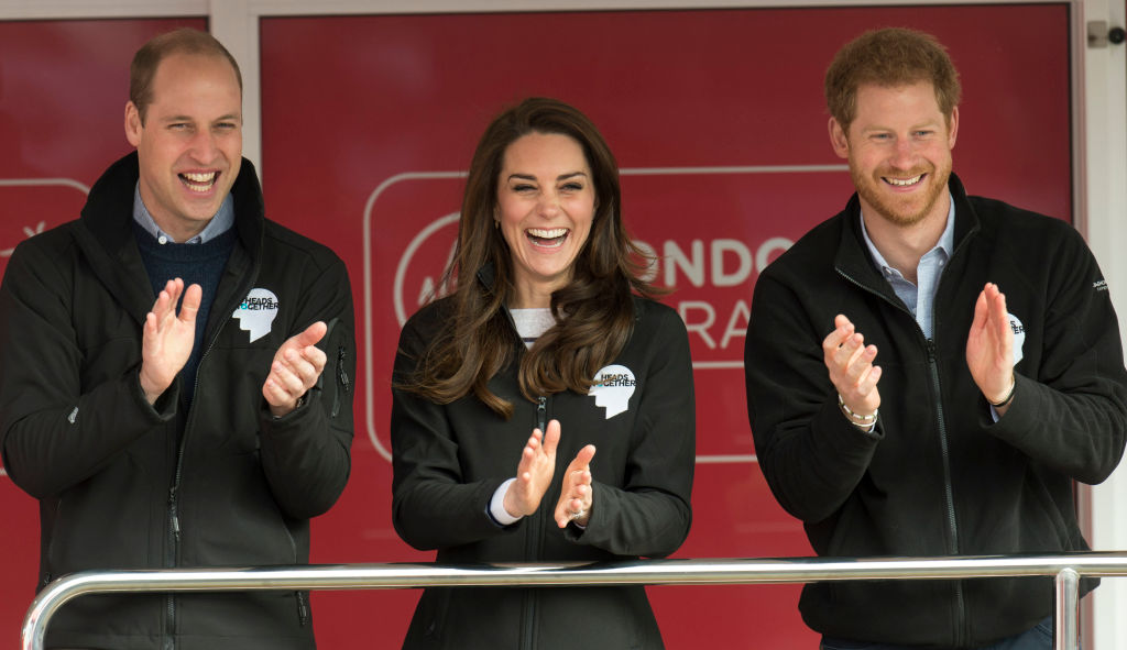 Prince Harry, Prince William, and Kate Middleton cheered on London Marathon runners with water bottles and hugs