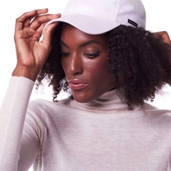 This fashion brand creates satin-lined dad hats because it's actually great for your hair