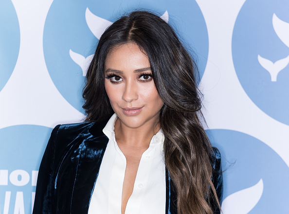 Shay Mitchell's crushed velvet pantsuit just became our new office-chic obsession