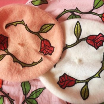 If you're thinking of jumping on the celebrity-approved beret trend, this embroidered rose style is the way to go