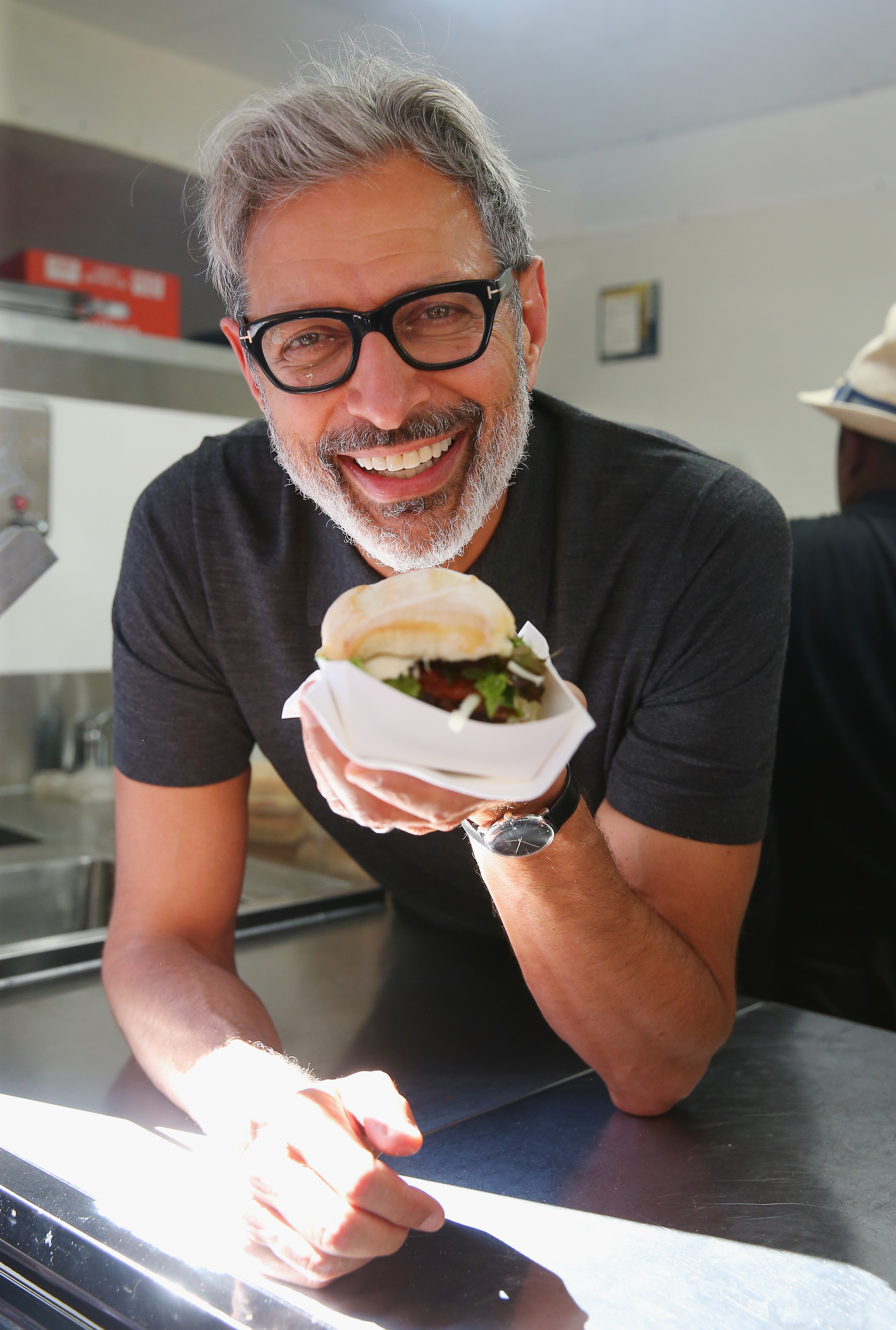 jeff goldblum is currently selling sausage out of a food