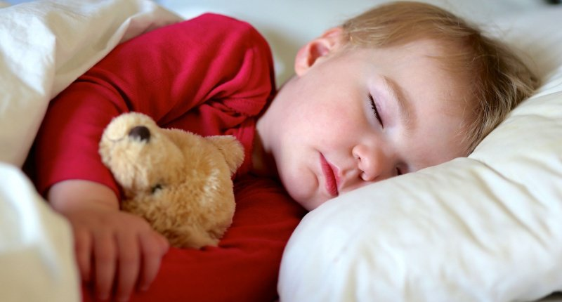 A new study says getting kids to sleep early will improve moms' mental health