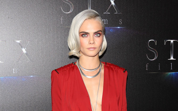 Cara Delevingne debuts her shaved head on the Met Gala red carpet — and it's silver