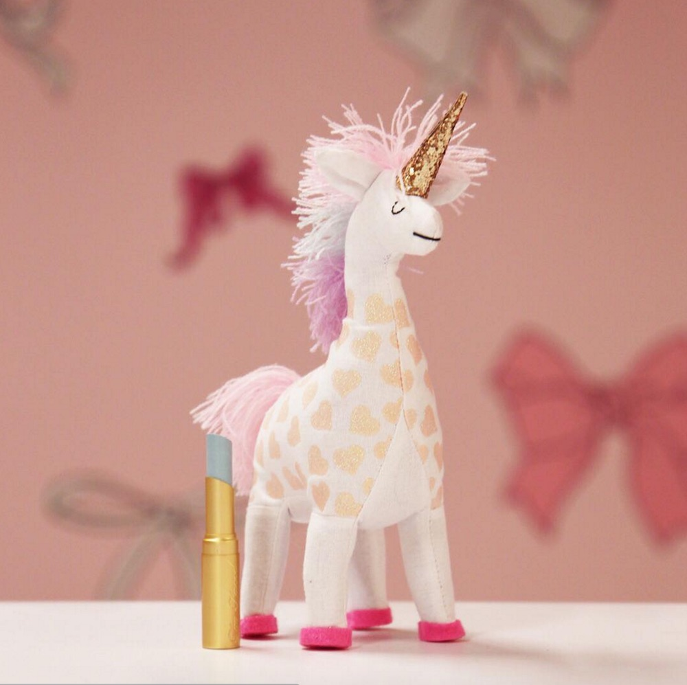 Too Faced is whipping up a mysterious new product, and it's giving us unicorn vibes
