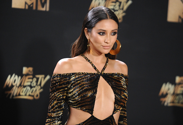 Shay Mitchell redefined what it means to slay in a sultry tiger-striped dress at the MTV Movie & TV Awards