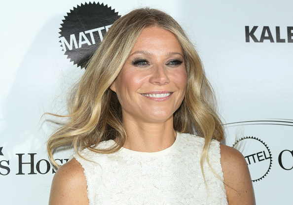 Gwyneth Paltrow demonstrates the adult way to wear a crop top and high-slit skirt