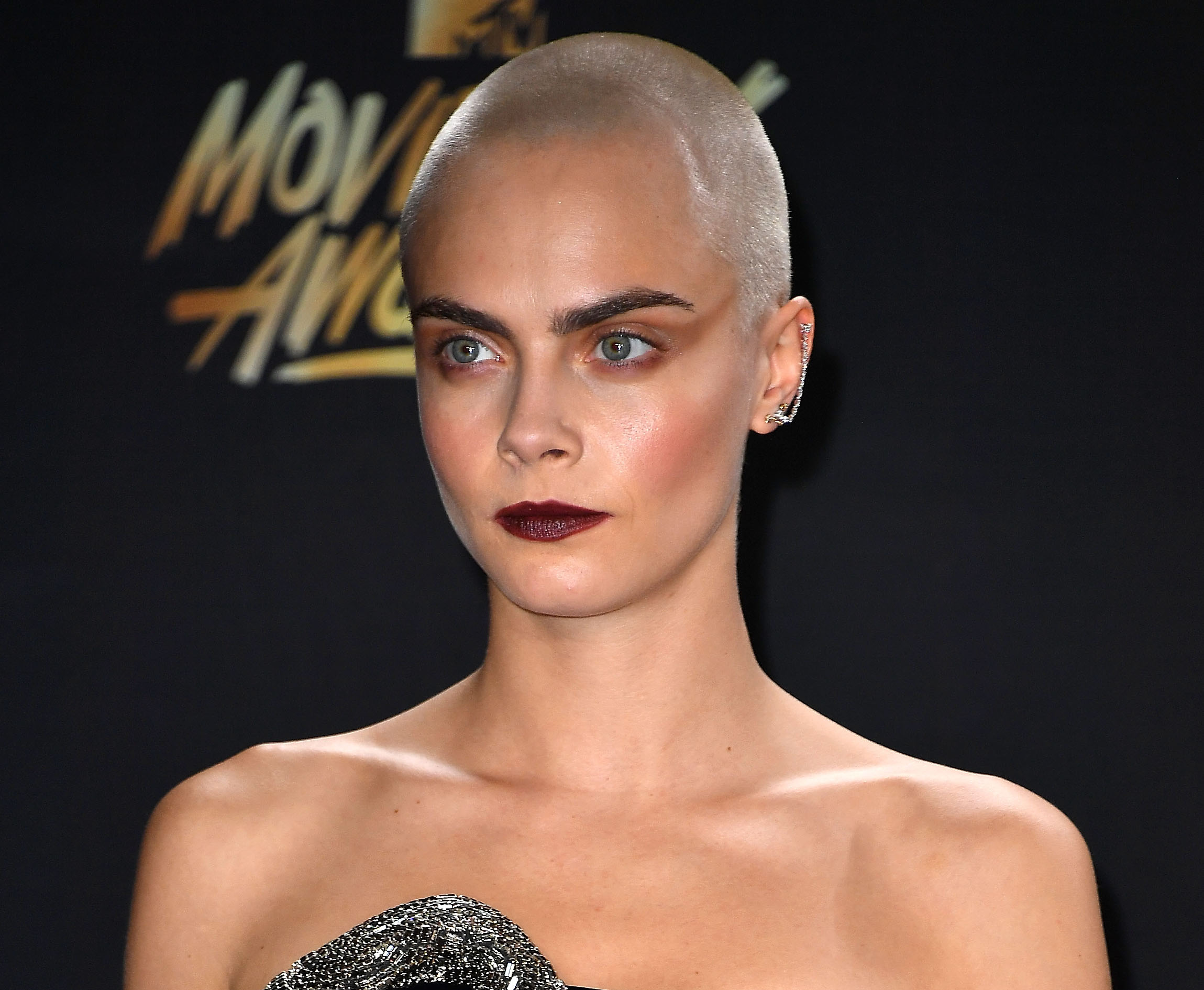 We can't quite figure out where Cara Delevingne's dress begins and ends