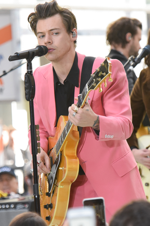 all of the yas for harry styles in a bubblegum pink suit