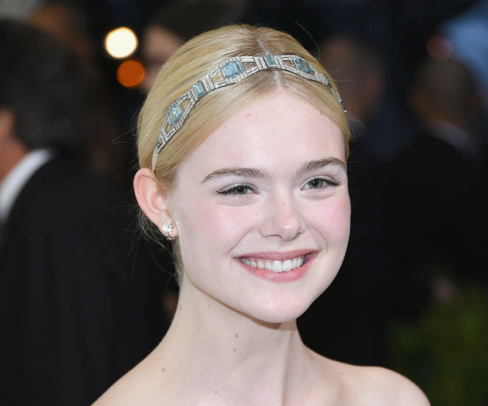 """Elle Fanning was transformed into a rose garden on the cover of """"Vogue"""""""