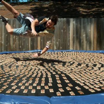 Watch this guy's slow-motion dive into 1,000 mouse traps on a trampoline