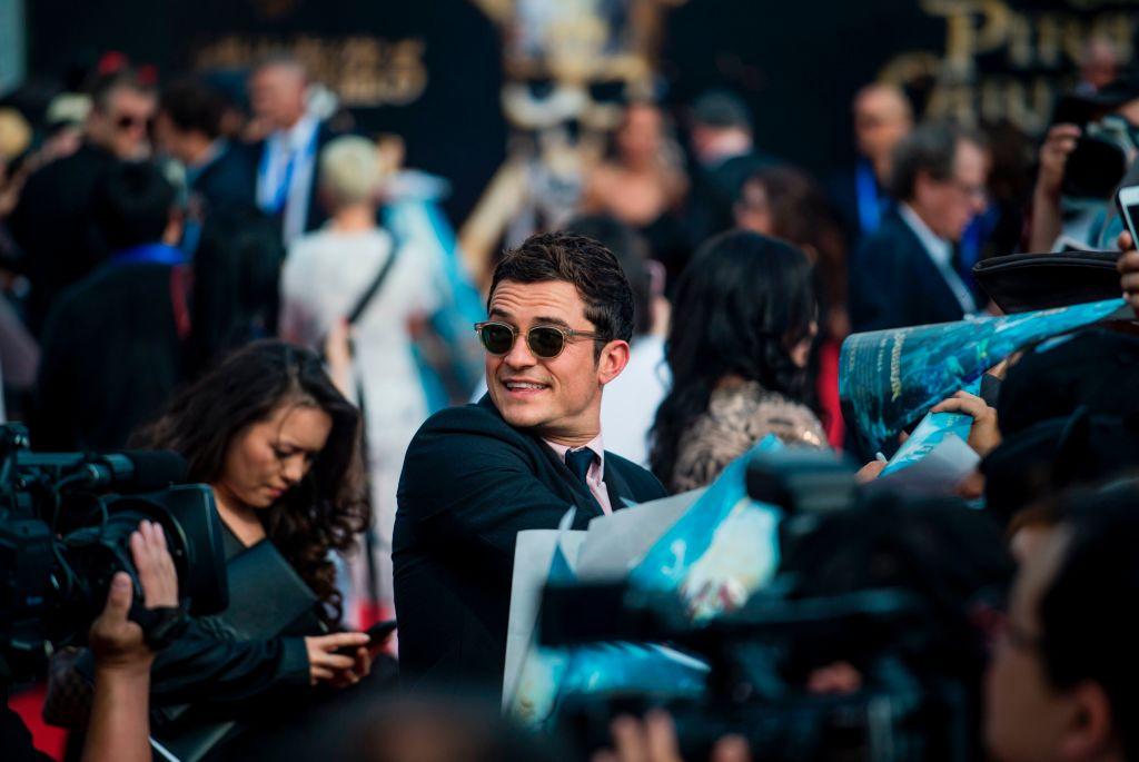 "Orlando Bloom made his grand ""Pirates"" re-entrance at the ""Dead Men Tell No Tales"" premiere in Shanghai"