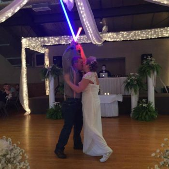 Forget first dance, this couple had a first *lightsaber duel* at their wedding