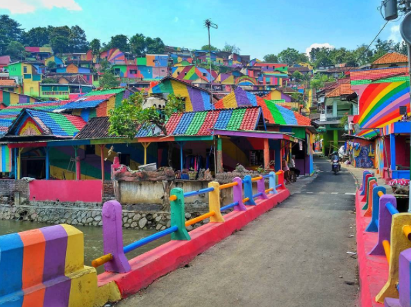 "We are moving to this ""rainbow village"" in Indonesia and never coming back"