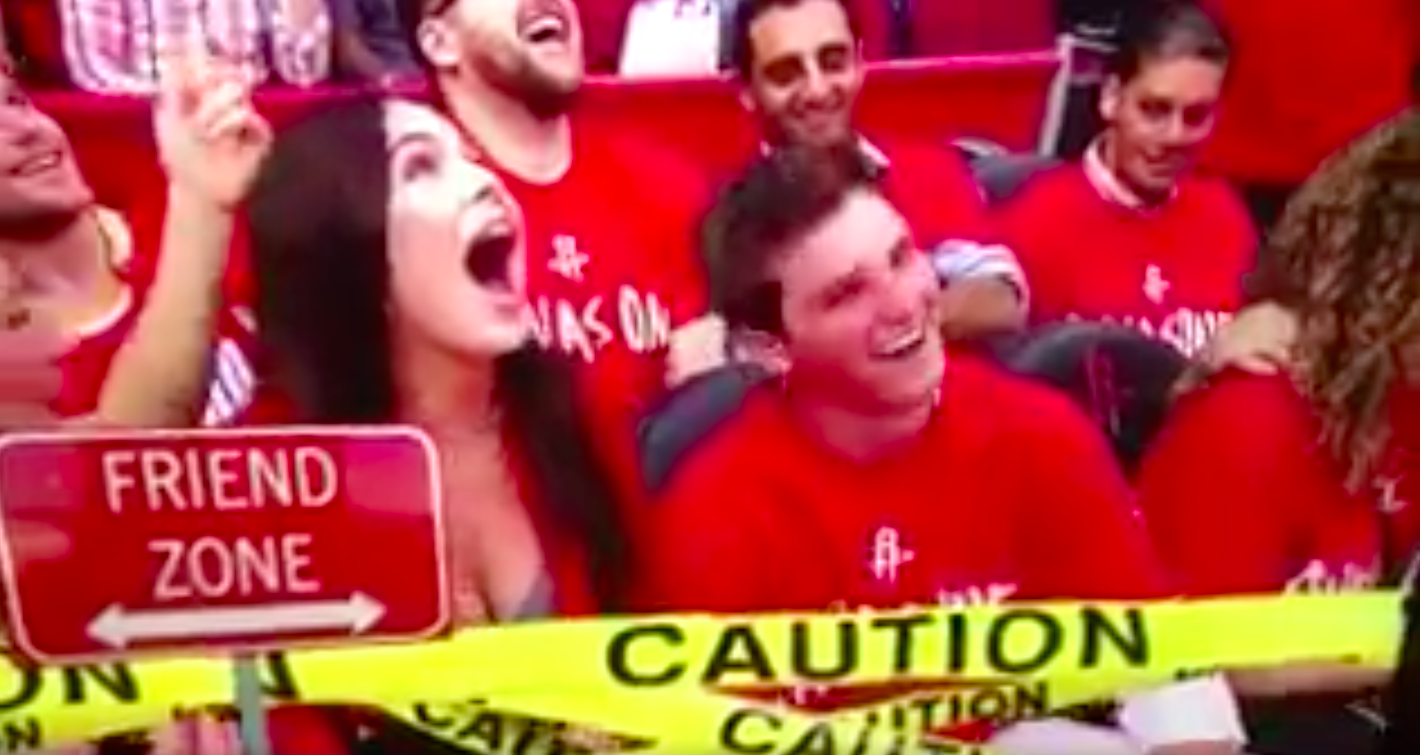 Awww, this dude totally got friend-zoned by his date on the kiss cam