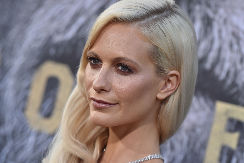 "Poppy Delevingne's turquoise gown at the ""King Arthur"" premiere looks made for Camelot"