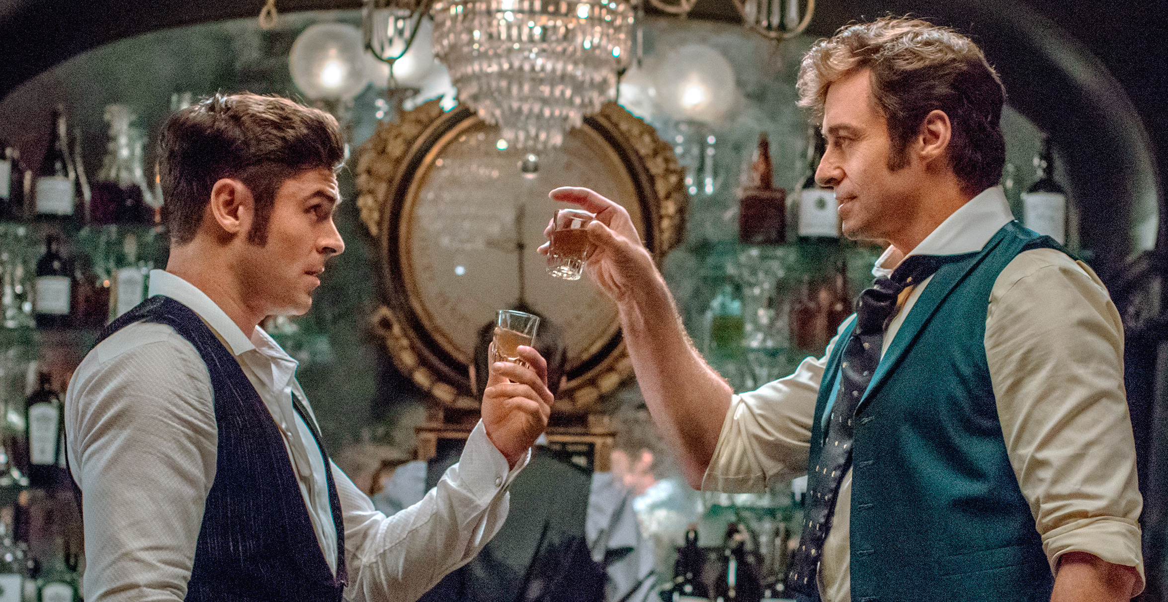 "Zac Efron and Hugh Jackman have sideburns for DAYS in the first images from ""The Greatest Showman"""