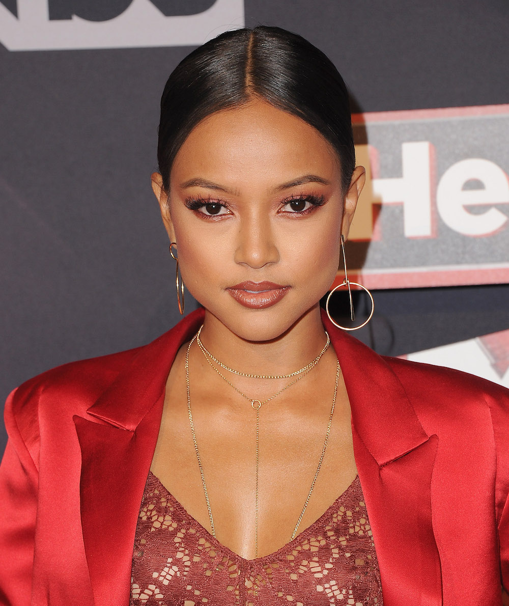 We're copying Karrueche Tran's hoodie skirt ensemble ASAP, because it looks chic and comfy at the same time