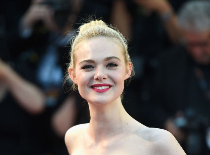 Elle Fanning is giving us literal lip service at Cannes, in this kiss-covered sundress