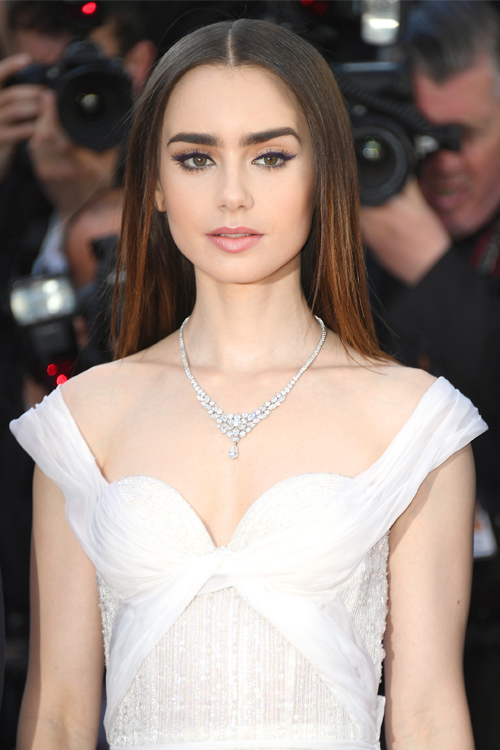 Lily Collins glimmered in a sheer dress that looks like it ...
