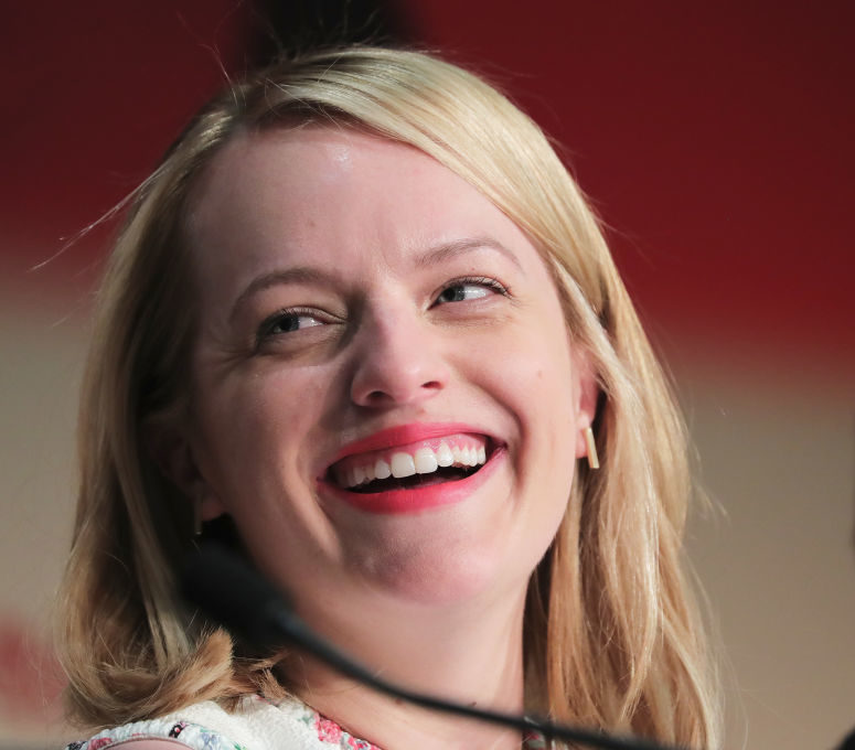 Elisabeth Moss just paired a ball gown with a leather jacket, and we are ALL about this