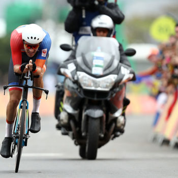 This cyclist stopped to poop during a race because hey, nature calls