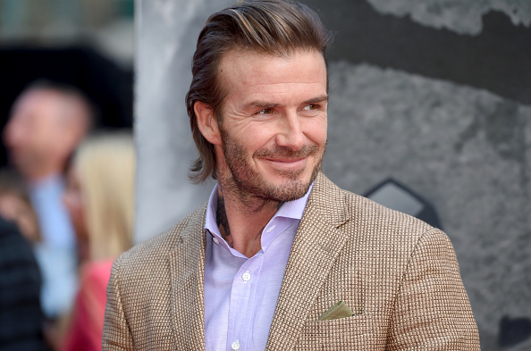 David Beckham is rocking the world's tiniest man bun at Cannes