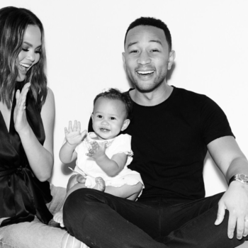 Luna is totally entranced by her dad, John Legend, at his concert, cause who wouldn't be?