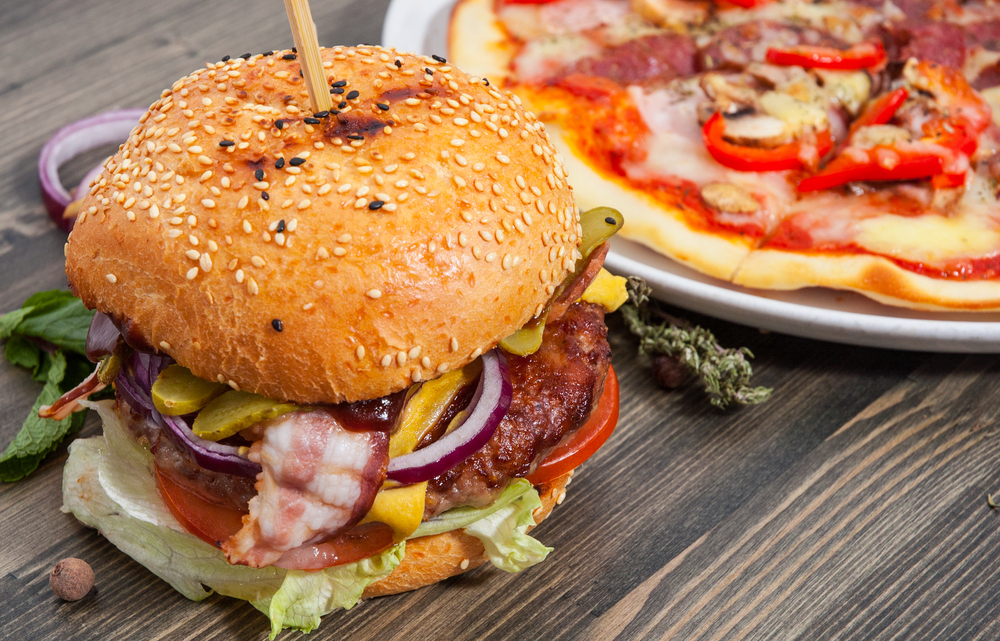 Papa John's just released a pizza that's part bacon burger and now we're sure we live in the Matrix