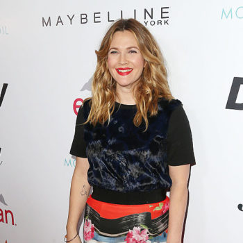 It looks like Drew Barrymore is handing out magazines on the streets of NYC today