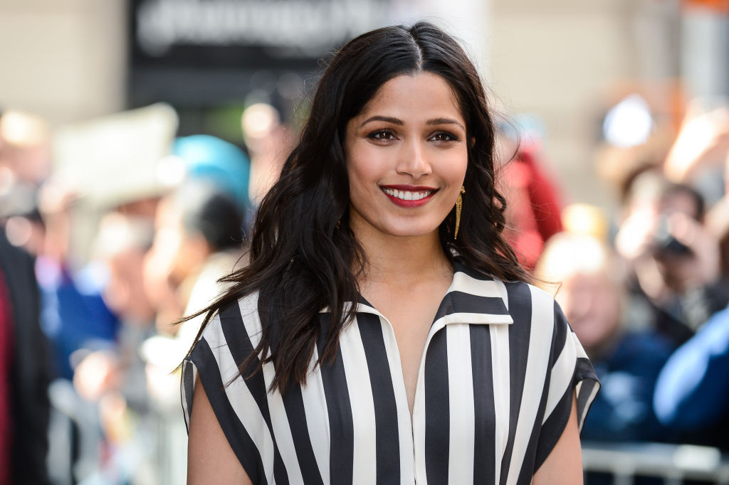 Freida Pinto's stunning black and white ensemble makes us realize we require a seriously enormous hat this summer