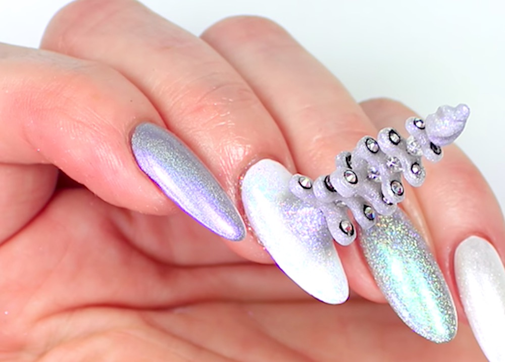 This nail artist combined the unicorn and fidget spinner trends, and somehow put them on nails