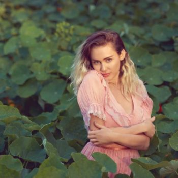 "Miley Cyrus talks about being ""yourself"" while experimenting with different phases"
