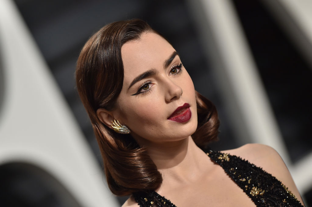 Lily Collins' waist-length ponytail might make you rethink your summer haircut plans