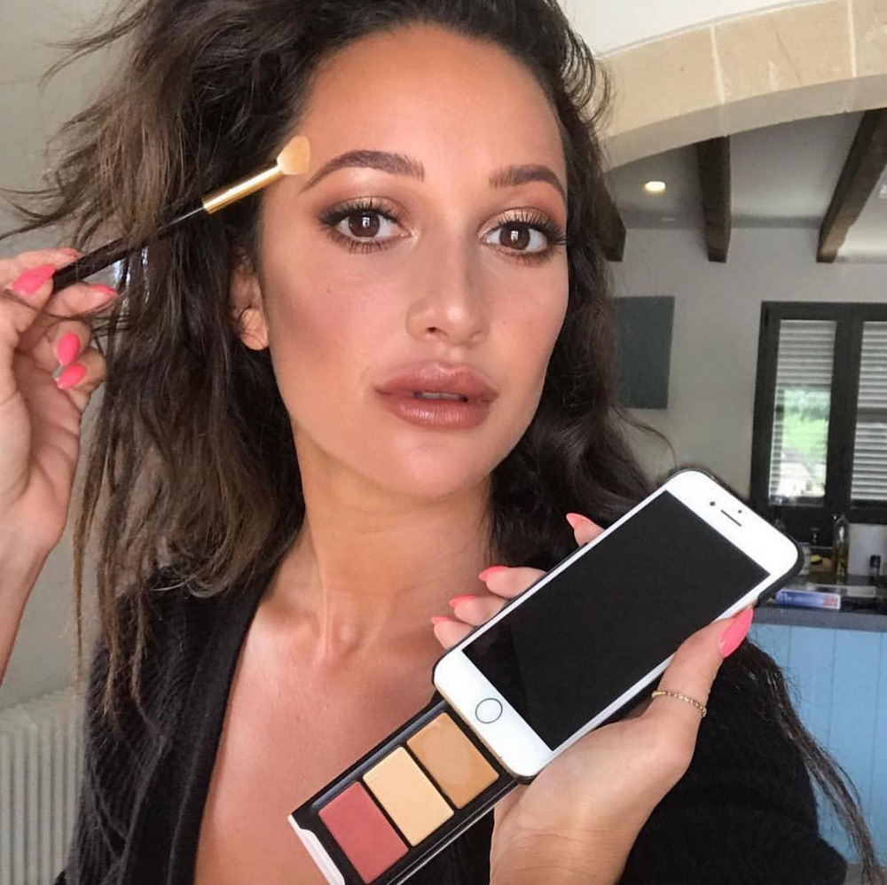 This phone case has a genius makeup palette compartment, and it's going to take your selfies to a new level