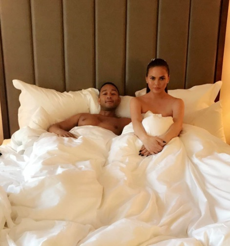 Chrissy Teigen showed up naked with a cake to John Legend's hotel room on Father's Day because #goals