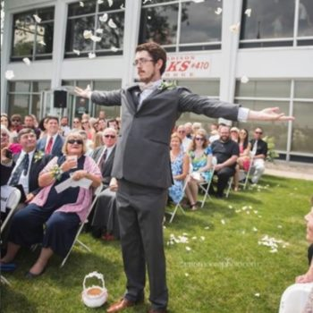 An adult man was the flower girl at his cousin's wedding, and we applaud his commitment