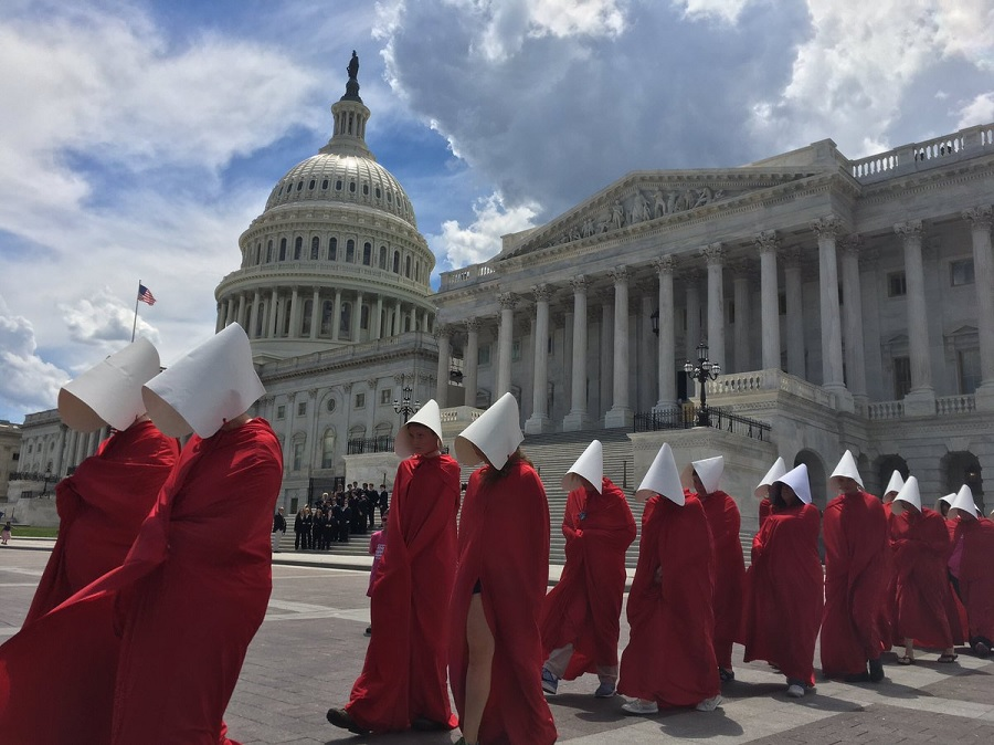 """Handmaids"" staged a silent protest outside the U.S. Capitol building, and it was an eerie (and beautiful) sight"