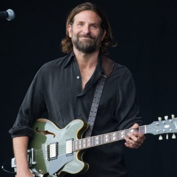 Oh, so *this* is why Bradley Cooper was playing the guitar onstage during that music festival