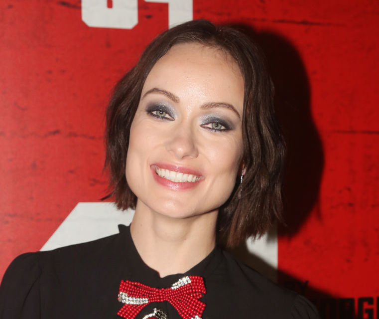 "Olivia Wilde's outfit is giving us Ben Stiller in ""The Royal Tenenbaums"" vibes"
