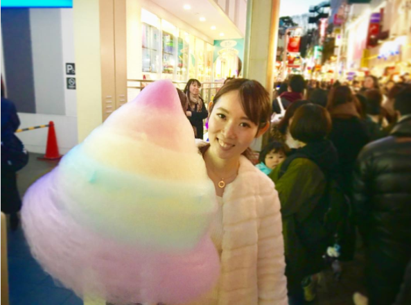 This giant rainbow cotton candy is half the size of a person's body