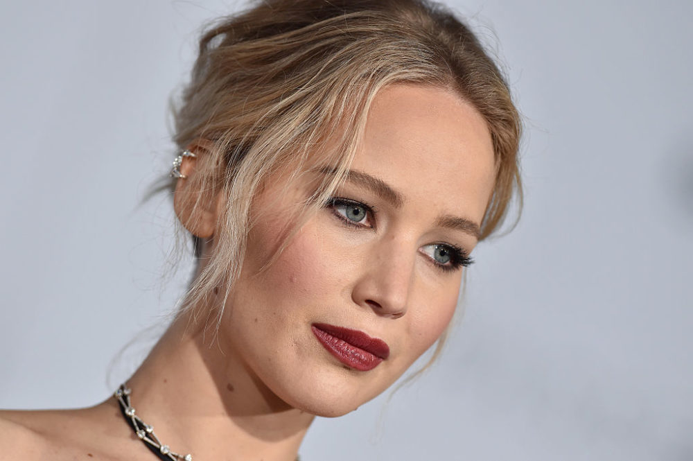 Jennifer Lawrence was incognito AF in an oversized hat and shawl at the Dior show